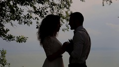 The couple looked at each other in the sky. Standing direct sunlight. Stock Footage