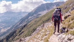Young Man With Backpack Hiking On Mountain Trail Adventure Extreme Sport Leisure Stock Footage
