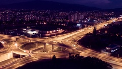 Illuminated City And Interchange Overpass At Night Aerial Drone Highway  Traffic Stock Footage