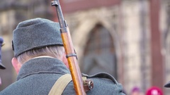 Close up to  rifleman with vintage gun. Historic procession military units Stock Footage