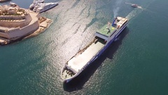 Aerial Drone Footage Of Cargo Ship Sailing In Mediterranean Sea Summer Malta Stock Footage