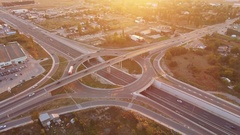 Traffic On Road Interchange And Overpass  Roundabout Highway Transportation Stock Footage