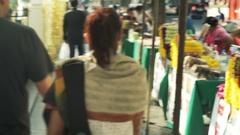 People walking through market stall in Bangkok Stock Footage