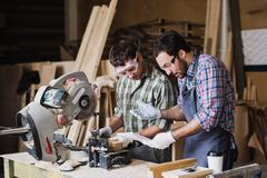 Inspector and carpenter discuss the process of making wood products for Stock Photos