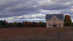 A decrepit farm house in a farmers field Stock Footage