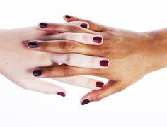 Manicured hands on white isolated, african with caucasian close up, connection Stock Photos