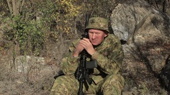 Automatic rifle and Adult Soldier in camouflage  Stock Footage