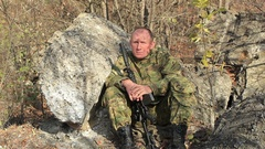 Adult Soldier in camouflage with automatic rifle   Stock Footage