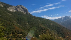 Timelapse of Cloudscape over Moro Rock in Sequoia National Park -Pan Right- Stock Footage