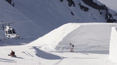 Helicopter take off on ski resort. Snowy mountains. Cameraman. Sunny day Stock Footage