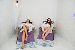 Two happy women relaxing in a SPA Salarium salt cave Stock Photos