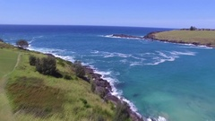 Swooping Drone Shot over grassy hills and Beach Stock Footage