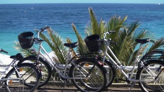 Comfortable bikes for active rest, travel around resort town, beautiful seascape Stock Footage
