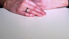 Hands of a woman taking off her engagement ring and putting it down in anger Stock Footage