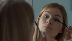 Woman applying mascara on her eyelashes. Ursa mini 4K shot Stock Footage