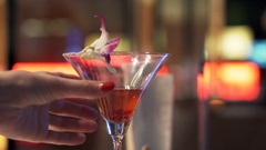 Female hand taking glass of cocktail in bar at night Stock Footage