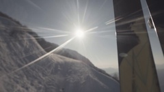 View of shining sun from window of ski lift on ski resort. Peaks of mountains Stock Footage