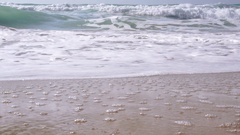 Gentle waves rolling to a sandy beach, half speed Stock Footage