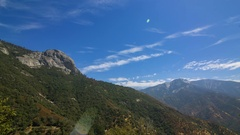 Timelapse of Cloudscape over Moro Rock in Sequoia National Park -Zoom In- Stock Footage