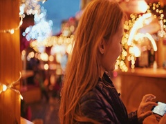 Woman Taking Pictures of European Christmas Market on Smartphone. 4K. Stock Footage