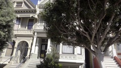 Driving past Painted Ladies houses - famous Full House properties San Francisco Stock Footage
