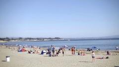Panning beach on bright sunny day in Santa Cruz Northern California Stock Footage