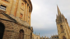 Panning shot revealing the large complex of college buildings in Oxford, UK Stock Footage