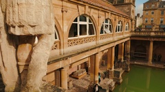 Tilting shot showing details of the Roman spa complex in Bath and the local Stock Footage