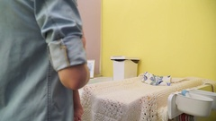 Mom puts his son on the changing table Stock Footage