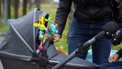 Parents playing with baby in stroller Stock Footage