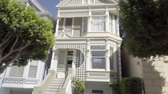 Driving past Painted Ladies historic houses in San Francisco CA Stock Footage