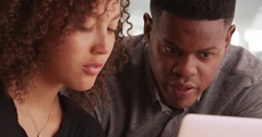 A young black man advises an African American woman while working  Stock Footage