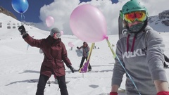Snowboarders and skiers ride with air balloons in hands. Ski resort. Event Stock Footage