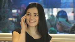 Attractive brunette talking on a mobile phone Stock Footage