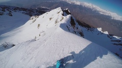 Snowboarder backcountry ride from top of snowy mountain. Dangerous. Extreme Stock Footage