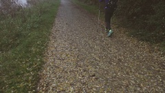 Nordic walker in a country trail in the mist Stock Footage