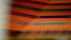 Close shot of designing of cloth in a power-loom. Stock Footage
