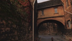 POV walk along a quaint passage in the old town of Oxford, UK Stock Footage