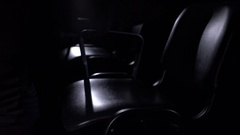 View of conductor sits on chair, close-up Stock Footage