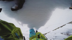 Snowboarder climb on top snowy mountain for backcountry ride. Sunny. Dangerous Stock Footage