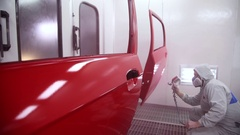 Man paints car door Stock Footage