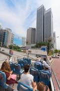 Tourists on bus with open air deck, Kuala Lumpur, Malaysia Stock Photos