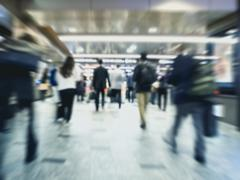 Business People walking Blur moving in Train station Travel Background Stock Photos