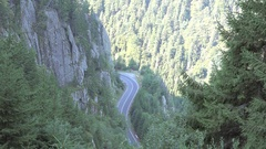 Cars driving carefully on winding road through the high mountains Stock Footage