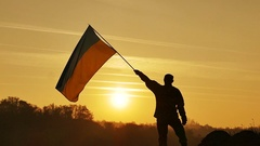 Soldier silhouette, Ukrainian Flag, sunrise time  in Slow Motion  Stock Footage