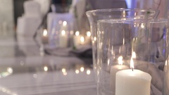 Romantic atmosphere created by candles, steles and silk Stock Footage