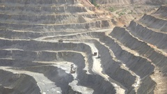 Machinery digs and truck carries ore stone from quarry Stock Footage