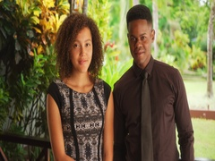 Young black millennial couple pose for a portrait in a tropical location Stock Footage