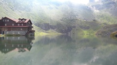 Wooden cottage near Balea alpine glacial lake on top of Fagaras mountains Stock Footage