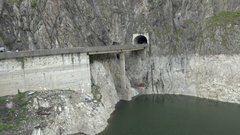 Mountain lake dam and tunnel viaduct Stock Footage